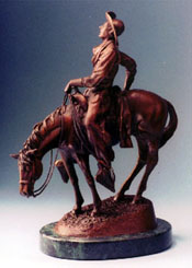 "Rear view of ""Longhorn Lullaby"", a bronze by L.D. Edgar, Western Heritage Studio, Cody Wyoming"